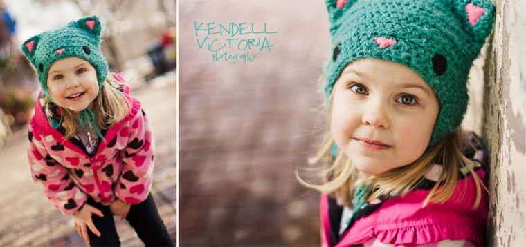 little girl in crochet kitty hat photographed in urban setting