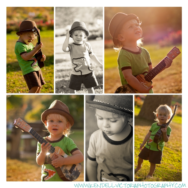 little boy wearing hat plays guitar